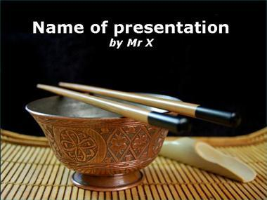 Bowl And Chopsticks on a table Powerpoint Template image